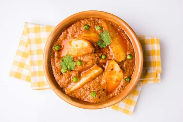 Potato and pea Peanut Butter Curry serves in a bowl