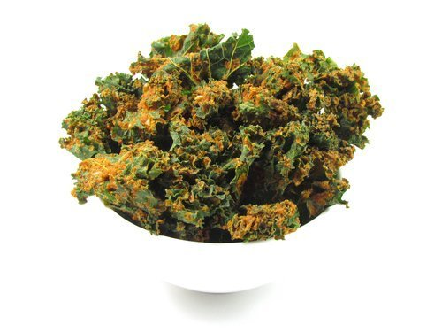 kale chips paprika in white bowl with white background